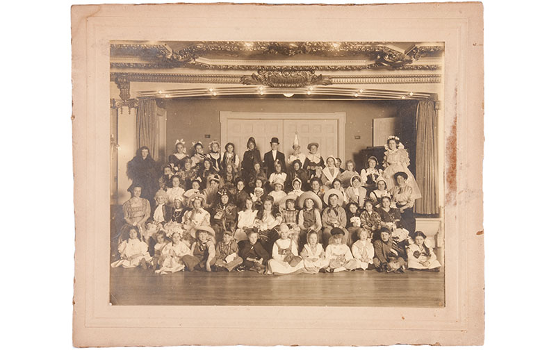 9fa84e7fb13 This early twentieth century silver gelatin developed-out print portrays a  large group of children of various ages dressed in costume.